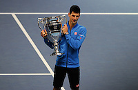 Novak Djokovic (SRB) celebrates with the year end ATP World Tour No.1 ranked player trophy during Day One of the Barclays ATP World Tour Finals 2015 played at The O2, London on November 15th 2015