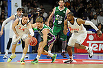 Real Madrid´s Rudy Fernandez and Marcus Slaughter and Unicaja´s Jon Stefansson during 2014-15 Liga Endesa match between Real Madrid and Unicaja at Palacio de los Deportes stadium in Madrid, Spain. April 30, 2015. (ALTERPHOTOS/Luis Fernandez)