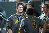 Andy Thomas (25) of the Baylor Bears shares a laugh with teammate Davion Downey (9) during the game against the Arkansas Razorbacks in game nine of the 2020 Shriners Hospitals for Children College Classic at Minute Maid Park on March 1, 2020 in Houston, Texas. The Bears defeated the Razorbacks 3-2. (Brian Westerholt/Four Seam Images)