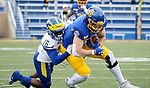 BROOKINGS, SD - MAY 8: Tucker Kraft #85 of the South Dakota State Jackrabbits is brought down by Nijuel Hill #16 of the Delaware Fightin Blue Hens on May 8, 2021 in Brookings, South Dakota. (Photo by Dave Eggen/Inertia)