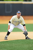 Wake Forest Demon Deacons third baseman Will Craig (22) on defense against the Virginia Cavaliers at Wake Forest Baseball Park on May 17, 2014 in Winston-Salem, North Carolina.  The Demon Deacons defeated the Cavaliers 4-3.  (Brian Westerholt/Four Seam Images)