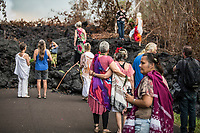 CONTACT PRH FOR USAGE RIGHTS; RESTRICTED USE ONLY. June 2018: Local residents hold a ceremony at a heiau to honor the Kilauea volcanic eruption and the people who lost their homes in Leilani Estates, Hawai'i Island.