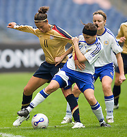 USWNT midfielder (11) Carli Lloyd is fouled by Finland's (14) Tuija Hyyrynen during the Four Nations Tournament in  Guangzhou, China.  The US defeated Finland, 4-1.