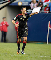 Mexico's Pablo Barrera points to the Mexican bench after scoring Mexico's fourth goal.  Mexico defeated Costa Rica 4-1 at the 2011 CONCACAF Gold Cup at Soldier Field in Chicago, IL on June 12, 2011.