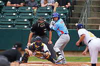 Tennessee Smokies second baseman Stephen Bruno (3) at bat in front of catcher Justin O'Conner and umpire Alex Ransom during a game against the Montgomery Biscuits on May 25, 2015 at Riverwalk Stadium in Montgomery, Alabama.  Tennessee defeated Montgomery 6-3 as the game was called after eight innings due to rain.  (Mike Janes/Four Seam Images)