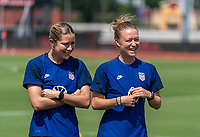 HOUSTON, TX - JUNE 12: Abby Dahlkemper #7 and Emily Sonnett #14 of the USWNT warm up during a training session at University of Houston on June 12, 2021 in Houston, Texas.