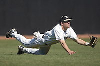 Left fielder Tyler Smith #3 of the Wake Forest Demon Deacons makes a diving attempt versus the Virginia Cavaliers at Wake Forest Baseball Park March 8, 2009 in Winston-Salem, NC. (Photo by Brian Westerholt / Four Seam Images)