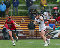 Newton, Massachusetts - May 19, 2018: NCAA Division I tournament, third round. In overtime, Boston College (white) defeated Stony Brook University (red/blue), 12-11, at Newton Campus Lacrosse Field.<br /> Goal.