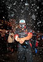 Nov 1, 2020; Las Vegas, Nevada, USA; NHRA funny car driver Matt Hagan celebrates with champagne after winning the 2020 funny car World Championship at the NHRA Finals at The Strip at Las Vegas Motor Speedway. Mandatory Credit: Mark J. Rebilas-USA TODAY Sports
