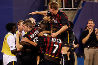 The MetroStars' John Wolyniec gets mobbed by teammates as he celebrates what would be the game winning goal as the Chicago Fire were defeated by the NY/NJ MetroStars 2-1 at Giant's Stadium, East Rutherford, NJ, on July 24, 2004.