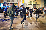 © Joel Goodman - 07973 332324 . Manchester , UK . 05/04/2015 . People dance in the street to the sound of a beat boxing duo , on Withy Grove in Manchester City Centre . Revellers on a Saturday night out during the Easter Bank Holiday weekend . Photo credit : Joel Goodman