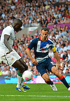 July 26, 2012..Senegal's Zargo Toure (6) and Britain's Ryan Giggs (11). Great Britain vs Senegal Football match during 2012 Olympic Games at Old Trafford in Manchester, England. Senegal held Great Britain to a 1-1 draw...(Credit Image: © Mo Khursheed/TFV Media)