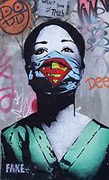 Nederland  Amsterdam   2021.   Super Nurse. De straatkunstenaar Fake maakte een kunstwerk van een verpleegster als Superwoman op de NDSM-werf in Noord.   Foto Berlinda van Dam / HH / ANP.