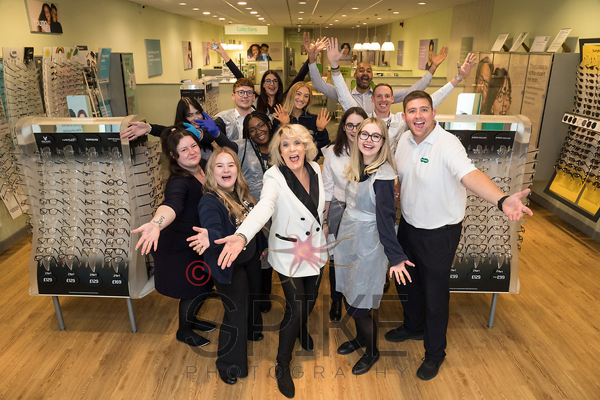 TV Star Sherrie Hewson and staff at Arnold Specsavers