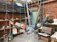 BNPS.co.uk (01202 558833)<br /> Pic: MarkRichards/BNPS<br /> <br /> Mark even suspended himself with ropes to work out the effects of weightlessness in his sculpture.<br /> <br /> The fine art of surfacing -  Artist Mark Richards has gone to extraordinary lengths to create a lifelike 'floating' sculpture in tribute to Royal Navy mine and bomb clearance divers to be installed at Gunwharf Quays in Portsmouth next year.<br /> <br /> In an attempt to replicate the feeling of being submerged Mark suspended himself with ropes and pulleys, photographed a Navy drysuit in a local swimming pool, and reproduced in minute detail all the equipment used by brave service personnel in their perilous work.<br /> <br /> The completed sculpture will now be scaled up to 1.25 life size and cast in bronze at Morris Singer foundry in Hampshire.