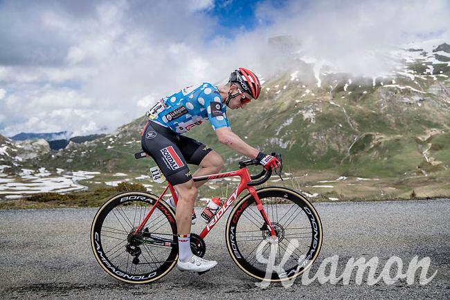 polka dot jersey / KOM leader Matthew Holmes (GBR/Lotto Soudal) up the snowy Cormet de Roselend (2cat/1968m/5.7km@6.5%)<br /> <br /> 73rd Critérium du Dauphiné 2021 (2.UWT)<br /> Stage 7 from Saint-Martin-le-Vinoux to La Plagne (171km)<br /> <br /> ©kramon