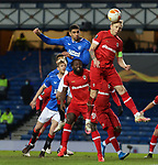 25.02.2021 Rangers v Royal Antwerp: Ritchie De Laet clears from Leon Balogun