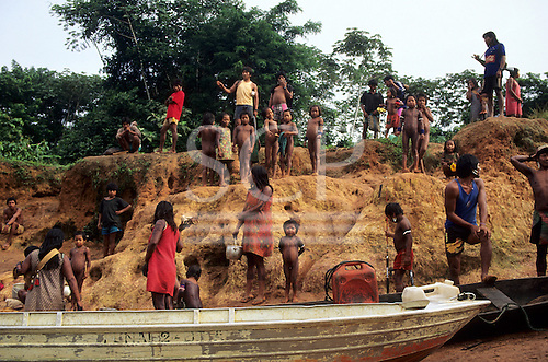 A-Ukre Village, Brazil. Kayapo men, women and children at the riverside, some with cooking pots. Para State.