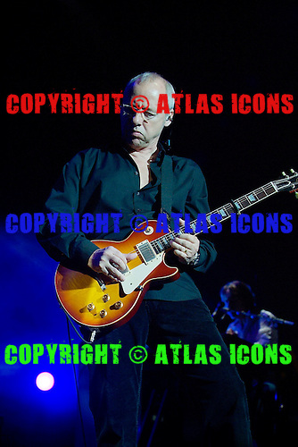 Mark Knopfler peforming live in concert at the Royal Albert Hall London UK - 30 May 2005.  Photo credit: George Chin/IconicPix/AtlasIcons.com