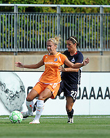 Skyblue FC midfielder Kacey White and Washington Freedom defender Ali Krieger (27). The Skyblue FC defeated the Washington Freedom 2-1 in first round of WPS playoffs at the Maryland Soccerplex, Saturday, August 15, 2009.