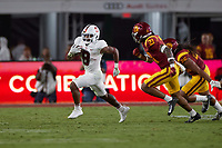 LOS ANGELES, CA - SEPTEMBER 11: Nathaniel Peat #8 of the Stanford Cardinal runs with the ball during a game between University of Southern California and Stanford Football at Los Angeles Memorial Coliseum on September 11, 2021 in Los Angeles, California.