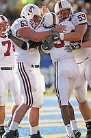 2 December 2006: Chris Marinelli and Josiah Vinson congratulate Richard Sherman during Stanford's 26-17 loss to Cal in the 109th Big Game at Memorial Stadium in Berkeley, CA.