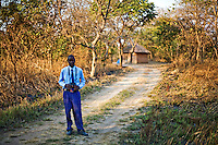 """16 year old Mweene Ng'andu from Kafinda basic school in Sereje district, on his first safari in Kasanka National Park. """"It is important to protect animals from poachers because they are part of wildlife. There are no wild animals where I live. I would like to see hippos but my favourite animal is a tiger."""" Local schools and women's groups are regularly brought into Kasanka, which is unique in the country and unusual in Africa as it is privately managed and owned by a trust. People are able to see animals flourishing in land which was once free reign for poachers. Combined with anti-poaching scouts, the education programme is on the frontline of conservation methods in the park, showing local people wild animals in their natural habitat."""