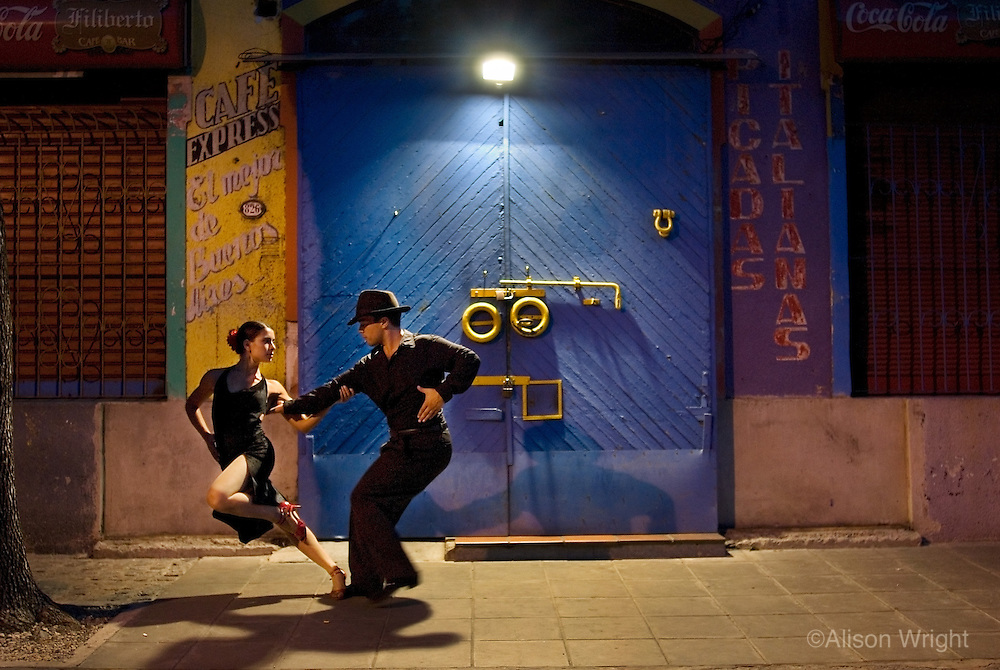 Argentina, couple dancing tango in La Boca, Buenos Aires