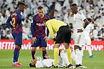 Real Madrid's Carlos Henrique Casemiro (d) dejected and Vinicius Junior (r), FC Barcelona's Nelson Semedo (l) and Arthur Melo (c) and Spanish referee Antonio Miguel Mateu Lahoz during La Liga match. March 1,2020. (ALTERPHOTOS/Acero)