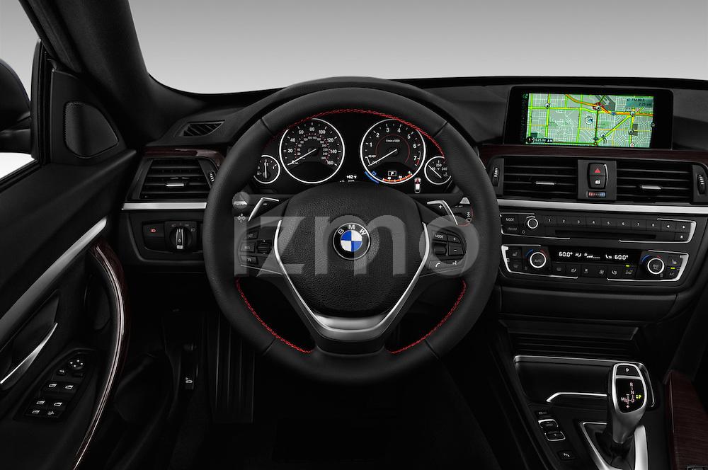 Car pictures of steering wheel view of a 2016 BMW 3 Series 328i 5 Door Hatchback Steering Wheel