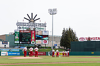 The Fresno Grizzlies stand in the field during the National Anthem before a game against the Reno Aces at Chukchansi Park on April 8, 2019 in Fresno, California. Fresno defeated Reno 7-6. (Zachary Lucy/Four Seam Images)