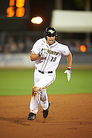 UCF Knights left fielder Bryce Peterson (13) running the bases during a game against the Siena Saints on February 17, 2017 at UCF Baseball Complex in Orlando, Florida.  UCF defeated Siena 17-6.  (Mike Janes/Four Seam Images)