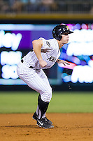 Josh Richmond (32) of the Charlotte Knights takes his lead off of second base against the Gwinnett Braves at BB&T Ballpark on August 19, 2014 in Charlotte, North Carolina.  The Braves defeated the Knights 10-5.   (Brian Westerholt/Four Seam Images)