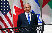 """Prime Minister Benjamin Netanyhu of Israel looks on as United States President Donald J. Trump and First lady Melania Trump host a signing ceremony of the """"Abraham Accords"""" on the South Lawn of the White House in Washington, DC on Tuesday, September 15, 2020.  The Trumps are joined by Prime Minister Benjamin Netanyahu of Israel; Sheikh Abdullah bin Zayed bin Sultan Al Nahyan, Minister of Foreign Affairs and International Cooperation of the United Arab Emirates; and Dr. Abdullatif bin Rashid Alzayani, Minister of Foreign Affairs, Kingdom of Bahrain.<br /> Credit: Chris Kleponis / Pool via CNP"""