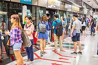 Singapore MRT Mass Rapid Transit Passengers Waiting to Board Train.