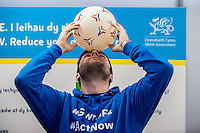 Friday 10 February 2017<br /> Pictured: Ian Robson of the promotions team balances a ball on his head<br /> Re:Welsh Government Dementia Risk Prevention Roadshow at the BT building, Swansea, Wales, UK