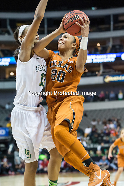 guard Brianna Taylor (20) drives past guard Alexis Prince (12) during Big 12 women's basketball championship final, Sunday, March 08, 2015 in Dallas, Tex. (Dan Wozniak/TFV Media via AP Images)