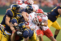 October 22th, 2011:  California Defense brings down Adam Schultz of Utah during a game at AT&T Park in San Francisco, Ca  -  California defeated Utah 34 - 10