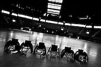 Wheelchairs are seen lined up before a wheelchair rugby training at the indoor sporting arena Coliseo in Bogota, Colombia, 29 January 2013. Wheelchair rugby, a full-contact team sport, was developed in Canada in 1977 under the name murderball. The game is played only by athletes with some form of disability in both the upper and lower limbs (quadriplegics). Attempting to score by carrying the ball across the goal line, four players from each team roughly crash into each other in specially designed armored wheelchairs. Although the team from Bogota is supported by a foundation (gear), quad rugby players, mostly coming from the remote, socially deprived neighbourhoods, often can not attend a training due to lack of funds for transportation. However, they still dream of representing Colombia at Rio 2016 Paralympic Games.