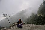 A Bhutanese laday waiting for a local bus. Phoontsholing. Bhutan Arindam Mukherjee..