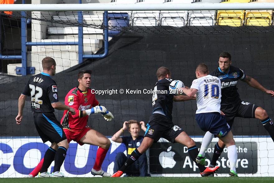 Stuart Beavon of Preston's shot is blocked by Jimmy Smith of Stevenage<br />  - Preston North End v Stevenage - Sky Bet League One - Deepdale, Preston - 14th September 2013. <br /> © Kevin Coleman 2013