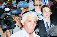 Press and delegates crowd together on a staircase in the delegate area before President Barack Obama's speech at the Democratic National Convention at the Wells Fargo Center in Philadelphia, Pennsylvania, on Wed., July 27, 2016.