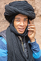 Morocco.  Teenage Amazigh Berber Young Man Talking on his Cell Phone, Ait Benhaddou Ksar, a World Heritage Site.