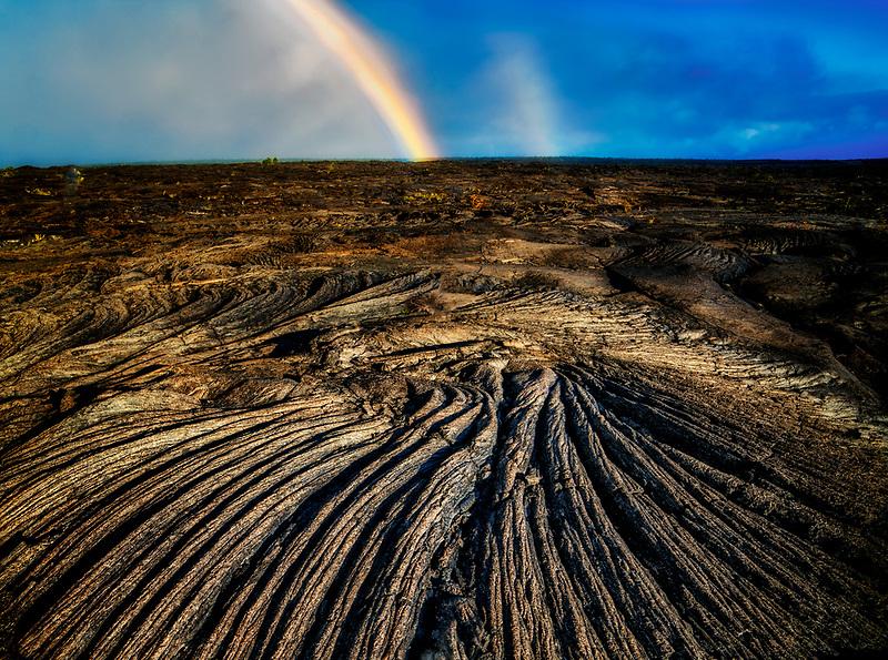 Rainbow over lava field. Hawaii Island