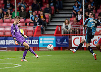 Goalkeeper Freddie Woodman of Crawley Town clears under pressure from Garry Thompson of Wycombe Wanderers during the Sky Bet League 2 match between Crawley Town and Wycombe Wanderers at Checkatrade.com Stadium, Crawley, England on 29 August 2015. Photo by Liam McAvoy.