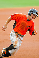 Johnny Ruettiger (14) of the Frederick Keys rounds third base during the Carolina League game against the Winston-Salem Dash at BB&T Ballpark on July 21, 2013 in Winston-Salem, North Carolina.  The Dash defeated the Keys 3-2.  (Brian Westerholt/Four Seam Images)