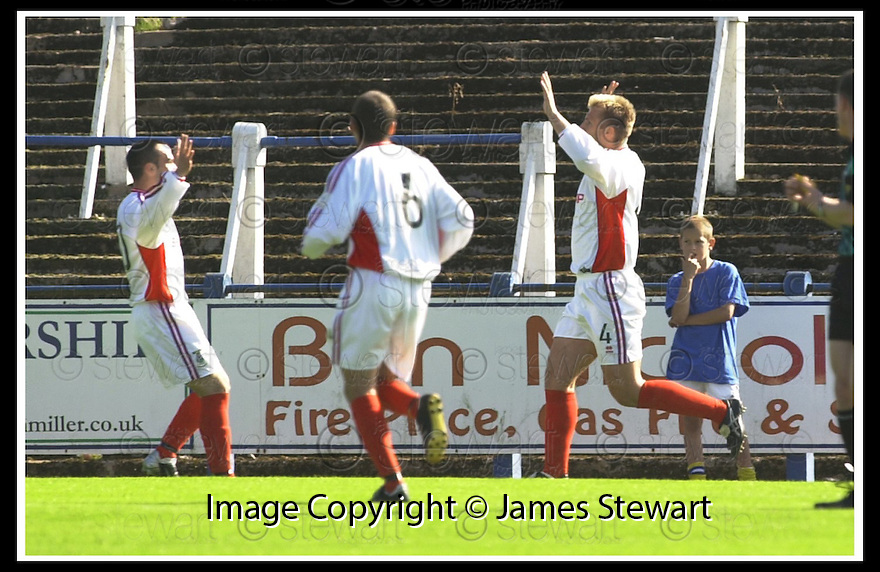 14/9/02       Copyright Pic : James Stewart                     .File Name : stewart-qots v inverness 07.ROBERT MANN (4) CELEBRATES WITH RICHARD HART AFTER HE SCORED THE FIRST GOAL....James Stewart Photo Agency, 19 Carronlea Drive, Falkirk. FK2 8DN      Vat Reg No. 607 6932 25.Office : +44 (0)1324 570906     .Mobile : + 44 (0)7721 416997.Fax     :  +44 (0)1324 570906.E-mail : jim@jspa.co.uk.If you require further information then contact Jim Stewart on any of the numbers above.........