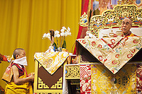 """Switzerland. Basel. St. Jakobshalle. His Holiness the Dalai Lama during the Buddhist ritual. Avalokiteshvara (Chenresig in tibetan) particularly embodies compassion of a Buddha indiscriminately directed to all sentient beings. Avalokiteśvara is a bodhisattva who embodies the compassion of all Buddhas. Avalokiteśvara is one of the more widely revered bodhisattvas in mainstream Mahayana Buddhism, as well as unofficially in Theravada Buddhism. 8.02.2015 © 2015 Didier Ruef<br /> <br /> <br /> <br /> The 14th and current Dalai Lama is Tenzin Gyatso, recognized since 1950. He is the current Dalai Lama, as well as the longest-lived incumbent, well known for his lifelong advocacy for Tibetans inside and outside Tibet. Dalai Lamas are amongst the head monks of the Gelug school, the newest of the schools of Tibetan Buddhism. The Dalai Lama, also called """" Ocean of Wisdom"""" is considered as the incarnation of Chenresi, the Bodhisattva of compassion who is also the protective deity of Tibet. 7.02.2015 © 2015 Didier Ruef"""