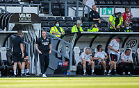 18th July 2021; Pride Park, Derby, East Midlands; Pre Season Friendly Football, Derby County versus Manchester United;  Derby County Manager Wayne Rooney standing  and Manchester United manager Ole Gunnar Solskjsaer seated