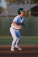 AZL Athletics second baseman Nick Ward (4) takes a lead off second base during an Arizona League game against the AZL Giants Orange at Lew Wolff Training Complex on June 25, 2018 in Mesa, Arizona. AZL Giants Orange defeated the AZL Athletics 7-5. (Zachary Lucy/Four Seam Images)